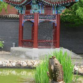 Chinese Pagoda And Stone Fish by Lesley Evered