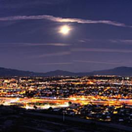 City lights of Tucson, Arizona skyline and moon panorama  by Chance Kafka