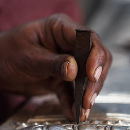 Close up of fingers of an artist working by Murray Rudd