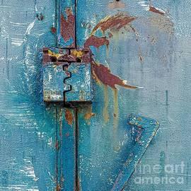 Closed Blue painted rustic metal lock garage door with security  by Rita Kapitulski
