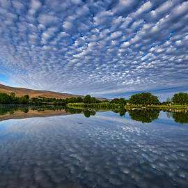 Cloudscape on the river by Lynn Hopwood