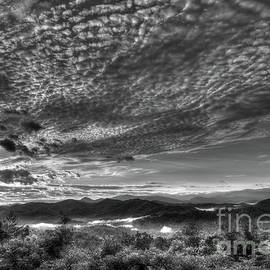 Cloudy Sunrise by Douglas Stucky