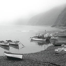 Clovelly 11 - Boats on a Stone Beach by Jerry Griffin
