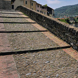 Cobbled footway of graceful 1400s Ponte Vecchio painted by Claude Monet, Dolceacqua, Liguria, Italy by Terence Kerr