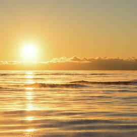 Cold Smoke and Waves - Polar Vortex Sunrise Overwater by Georgia Mizuleva