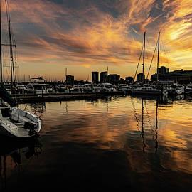 Colorful dusk sky by Chicago's Burham harbor by Sven Brogren