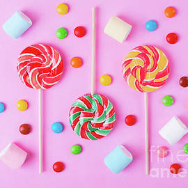 Colorful flat lay with sweets on pink by Oksana Chaun