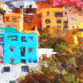 Colorful hilltop buildings in Guanajuato, Mexico by Tatiana Travelways