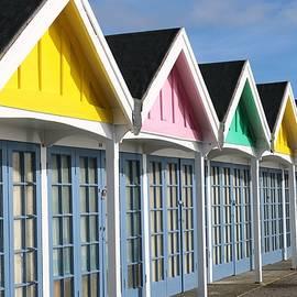 Colourful Beach Huts by Michaela Perryman
