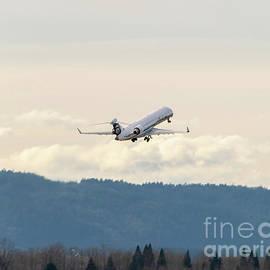 CRJ-700 Retracting Gear and Rising Into the Oregon Sky by Joe A Kunzler