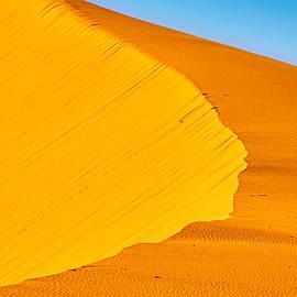 Curving Sand Dune Ridge and Sky - Morocco by Stuart Litoff