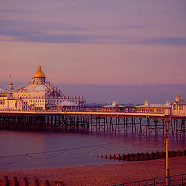 Dawn At Eastbourne Pier by Chris Lord