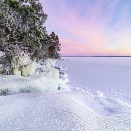 Dawn at the frozen lake by Juhani Viitanen