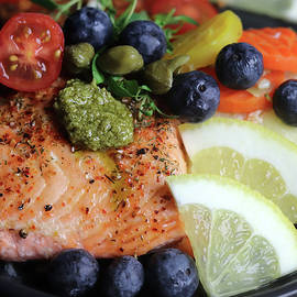 Delicious And Healthy Salmon With Blueberries Tomatoes And Capers by Johanna Hurmerinta