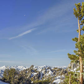 Desolation Wilderness during winter in the background as seen from about 10,000 feet elevation by PROMedias Obray