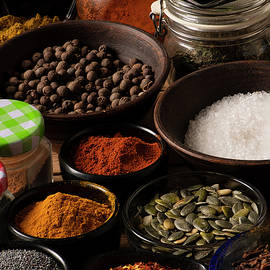 Different shape bowls full of Spices by Nick Paschalis