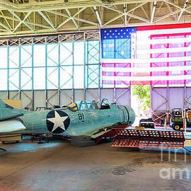 Douglas SBD Dauntless Dive Bomber in Repair at Hangar 79 in Pearl Harbor by Phillip Espinasse
