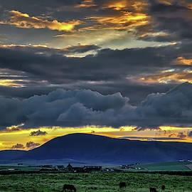 Dramatic evening sky over Orkney farmland by Robert Murray