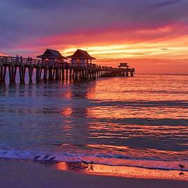 Dramatic Sunset At The Naples Pier by Karen Regan