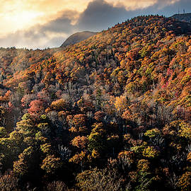Dramatic sunset with sun rays in Blue Ridge Parkway by Rod Gimenez