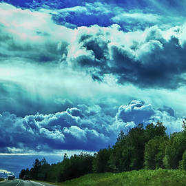 Driving under a stormy sky by Tatiana Travelways