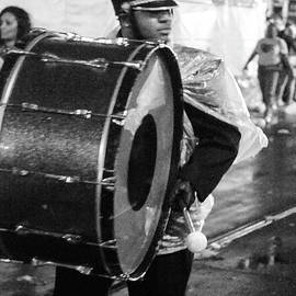 Drummer in the rain by Peter Foster