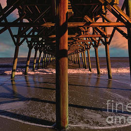 Dusk Under The Pier by Kathy Baccari