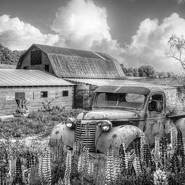 Early Morning Barns and Truck in Black and White by Debra and Dave Vanderlaan