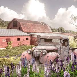 Early Morning Country Red Barns and Truck by Debra and Dave Vanderlaan
