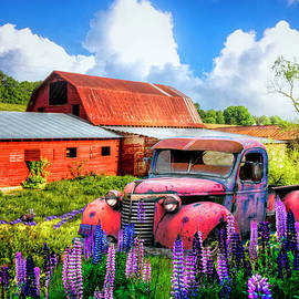 Early Morning Red Barns and Truck by Debra and Dave Vanderlaan