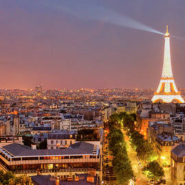 Eiffel Tower At Night In Paris by Paul Thompson