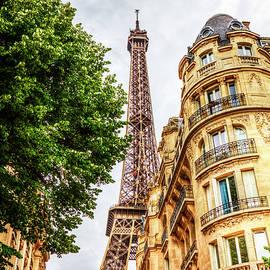 Eiffel Tower Paris, Between The Buildings by Paul Thompson