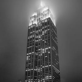 Empire State Building in Fog BW by Morey Gers