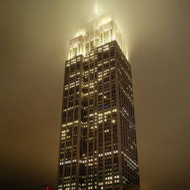 Empire State Building in Fog by Morey Gers