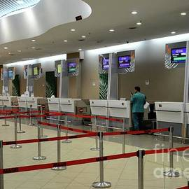 Empty Thai Air and other airline check in counters at Penang International Airport Malaysia by Imran Ahmed