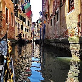 Enjoy floating on the Canals of Venice by Lyuba Filatova