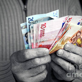 Euro banknote in human hands by Gregory DUBUS
