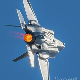 F-35a Going Wing Over In Full Afterburner by Joe A Kunzler
