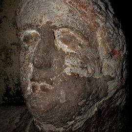 Face of man who once lived in ancient Etruscan city of Tarchuna preserved at Tarquinia, Lazio, Italy by Terence Kerr