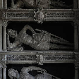 Family effigies wear Tudor armour on tiered shelves in Cotswolds church, Swinbrook, Oxfordshire, UK by Terence Kerr