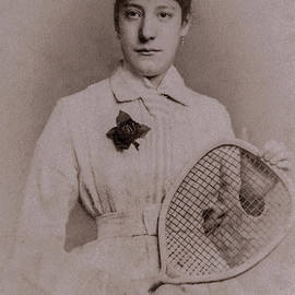 Female lawn tennis player, holding racquet and wearing tie, in the late 1800s - vintage photograph by Terence Kerr