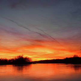 Fiery Sunset on the River by Rod Seel