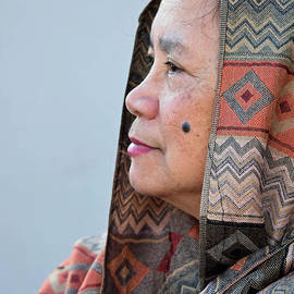 Filipina Woman with a Mole on Her Cheek Wearing a Decorative Scarf by Jim Fitzpatrick