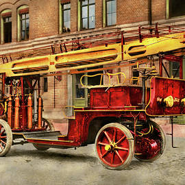 Fire Truck - An electric ladder truck 1907 by Mike Savad