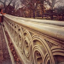 First Flurry - Snow on the Bow - Bow Bridge - Central Park New York by Miriam Danar