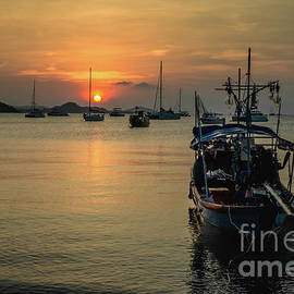 Fishing Boat And Sunset by Michelle Meenawong