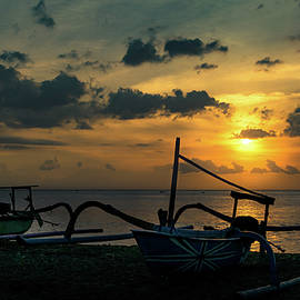 Fishing Boat At Sunset In Bali by Sergio Florez Alonso