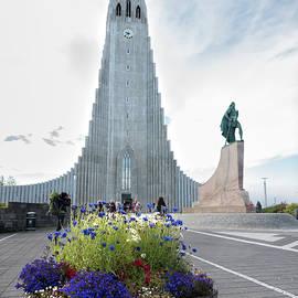 Flower pot, statue of explorer Leif Erikson and Hallgrimskirkja in Reykjavik by RicardMN Photography