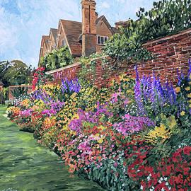 Flowers Along The Brick Wall by David Lloyd Glover