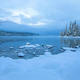 Fog and blue skies at Lake Wenatchee by Lynn Hopwood